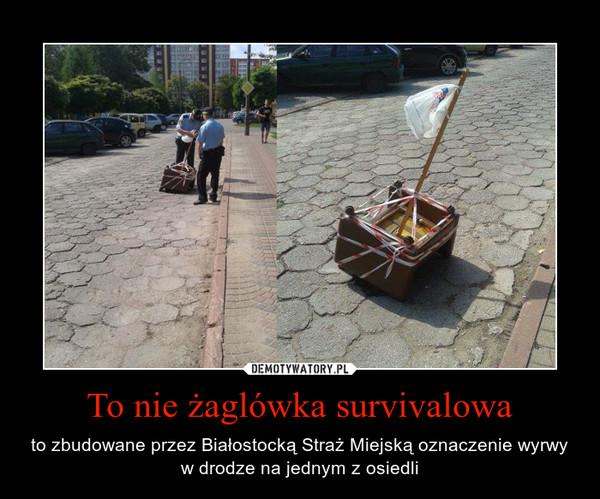 To nie żaglówka survivalowa – to zbudowane przez Białostocką Straż Miejską oznaczenie wyrwy w drodze na jednym z osiedli